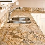 yellow-river-granite-with-white-cabinets